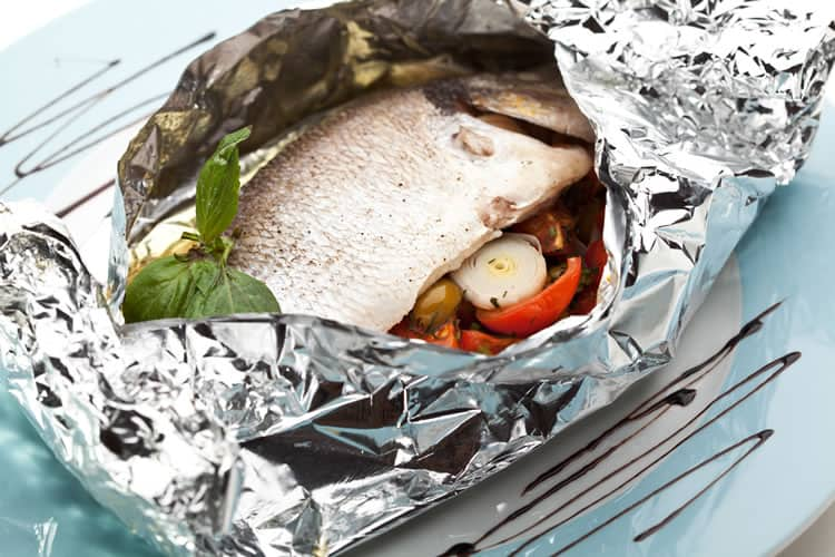 Fish in foil with cherry tomatoes